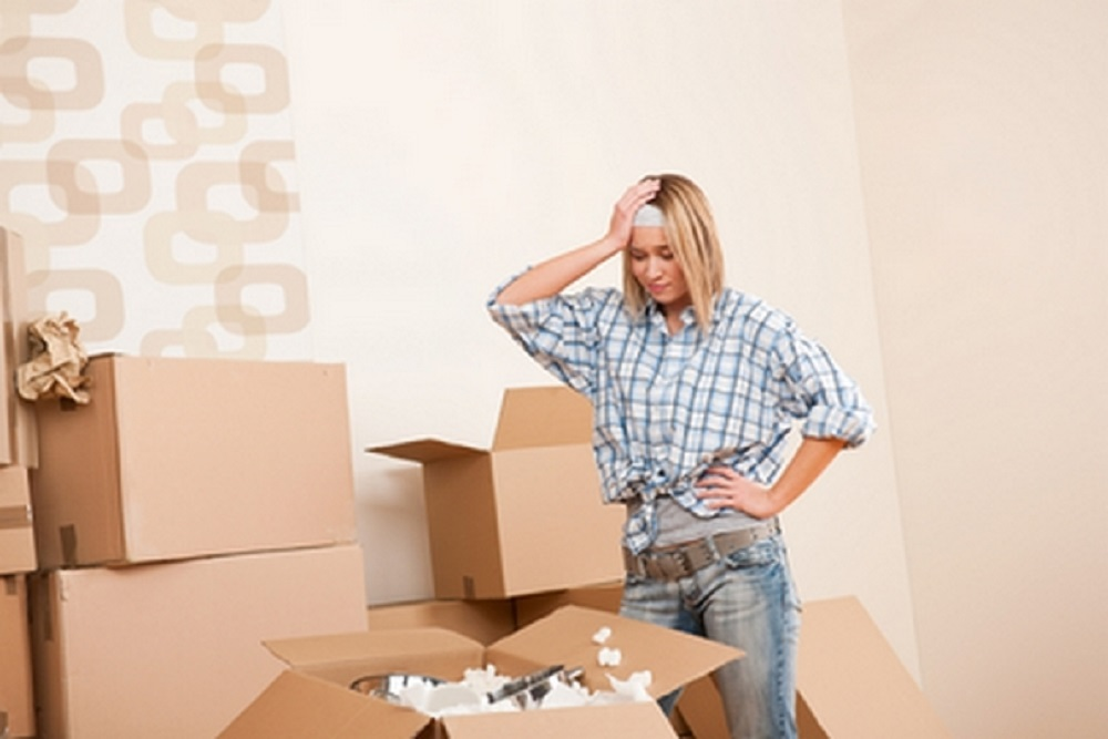 a girl stressed out with packing household items