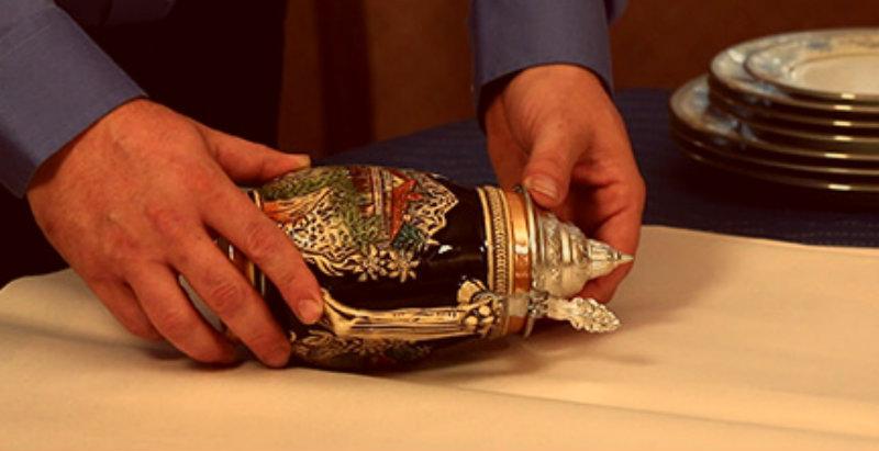 A man packing an antique vase