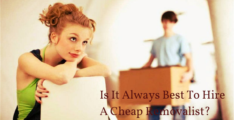 A girl sitting and wondering while a guy carries a packed box