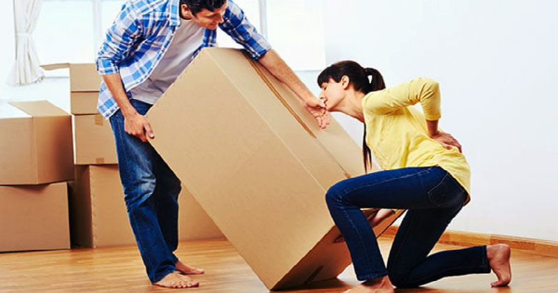 Women hurt while carrying a heavy cardboard box