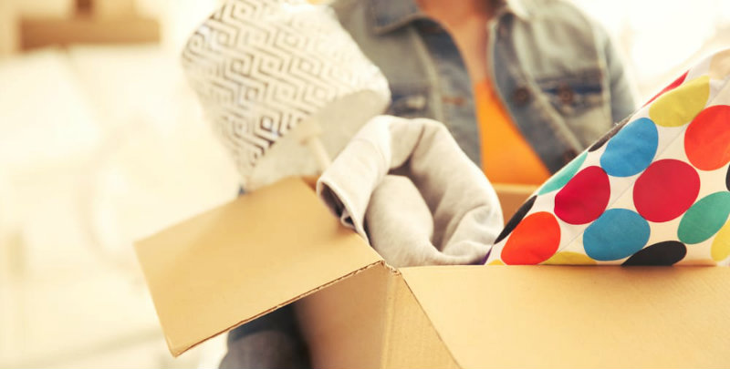 cropped image of woman holding packed box
