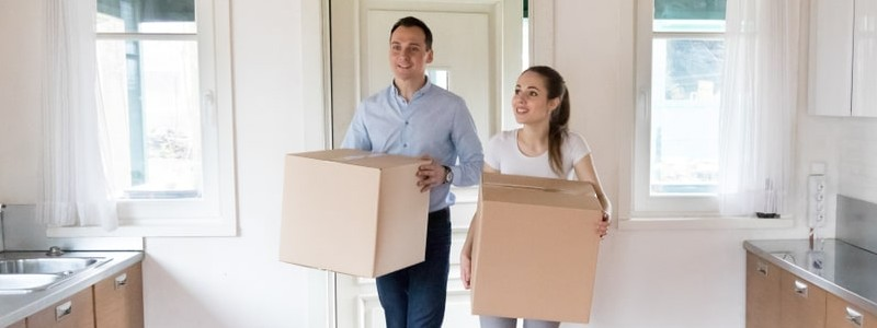 a couple is moving in a new apartment