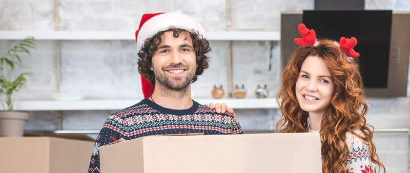 a couple preparing for a relocation during Christmas holidays
