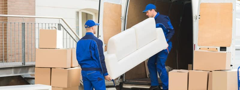 professional movers loading a couch into a moving truck
