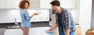 couple packing household for relocation