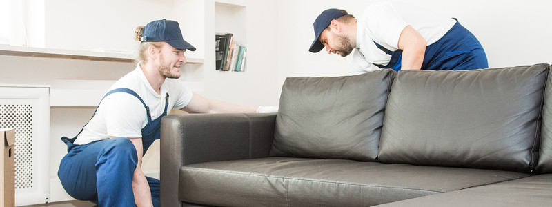 young professionals trying to move a couch