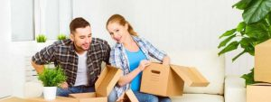 young couple packing their household for a relocation