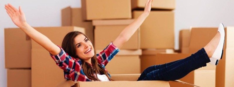 young woman looking happy after relocating to her new house